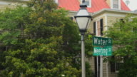 MS Shot of Charleston South Carolina street signs at Meeting Street and Water Street / Charleston, South Carolina, United States