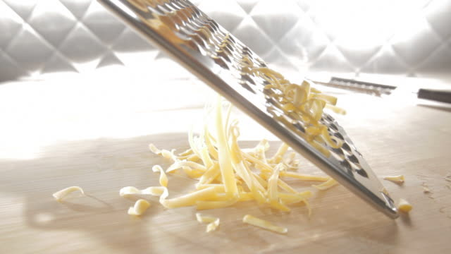 CU Shot of cheese being shredded / Los Angeles, California, United States