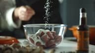 CU SLO MO Shot of chef pouring flour on to chopped up beef