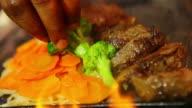 CU Shot of chef preparing and finalizing dish / Belo Horizonte, Minas Gerais, Brazil