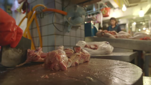 CU Shot of chicken being cutting in man in market / Taipei, Taiwan