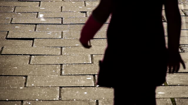MS Shot of Child tiptoes over paving stones, avoiding stepping on cracks / London, United Kingdom