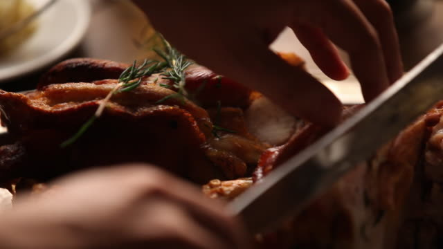 Shot of chopping meat with carving knife