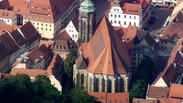 MS AERIAL Shot of church and buildings rooftops at Pirna / Germany