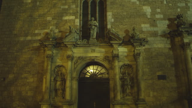MS LA R/F Shot of Church Doorway with Statues / Riga, Latvia