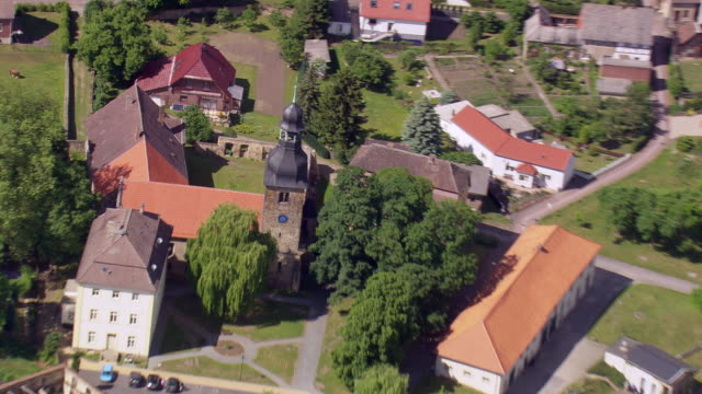 MS AERIAL Shot of church in small town near highway A2 / Germany