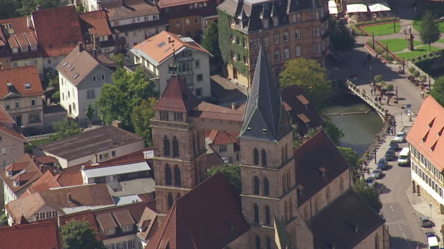 MS AERIAL TS TD Shot of Church on river surrounding by houses in Stuttgart Region / Esslingen, Baden Wurttemberg, Germany
