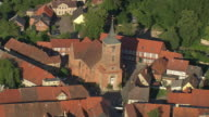 MS AERIAL Shot of church with Half-Timbered Houses at Lenzen shots / Germany