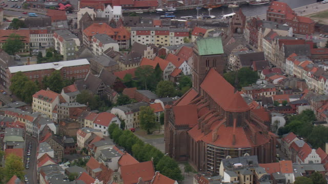 MS AERIAL Shot of church with other buildings at Wismar / Germany