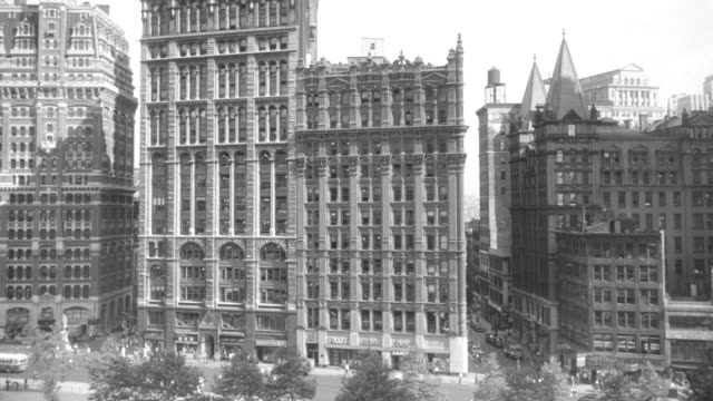 MS Shot of city hall and large buildings with traffic moving on street in New York city