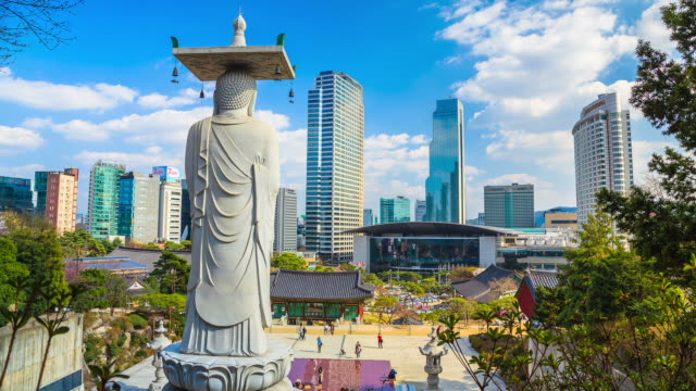 MS T/L Shot of Cityscape around Bongeuns with statue of buddhist ( Buddhist temple located in Seoul) / Seoul, South Korea