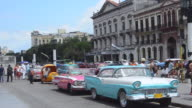 MS Shot of classic American 50s Ford automobiles at busy streets of Havana Habana Cuba downtown by Capital / Havana, Cuba