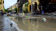 MS Shot of Clearing up street after floods / Hoi An, Quang Nam, Viet Nam