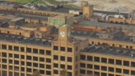 MS ZI AERIAL Shot of clock tower at old Firestone factory building / Akron, Ohio, United States