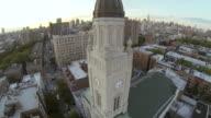 MS AERIAL SLO MO ZI TU Shot of clock tower church with city skyline / New York, United States