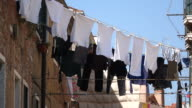 MS Shot of clothes hang to dry in sun at front of house in Arsenale / Venice, Veneto, Italy