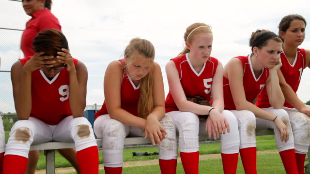 MS Shot of Coach with softball team after losing game / Albany, New York, United States