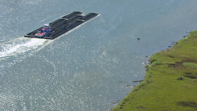 MS AERIAL Shot of coal barge moving on Mobile Delta / Mobile, Alabama, United States