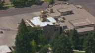 CU AERIAL TS Shot of Cody Courthouse and clock tower / Cody, Wyoming, United States