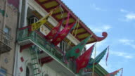 MS LA Shot of Colorful banners hanging from Chinese style building in Chinatown / San Francisco, California, United States
