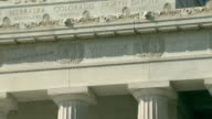 CU TU Shot of columns and state names at top with sunny sky at Lincoln Memorial / Washington, District of Columbia, United States