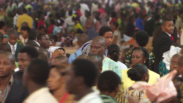 MS Shot of congregation leaving church / Lagos Nigeria