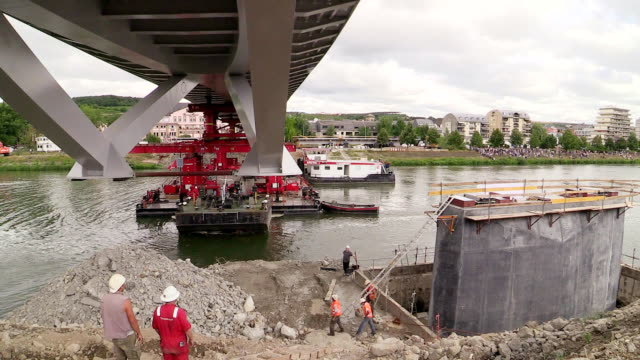 MS TL Shot of construction of new bridge over river / Grevenmacher, Moselle, Luxembourg