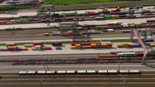 MS AERIAL Shot of container train terminal with cranes, containers and rail tracks / Munich, Bavaria, Germany