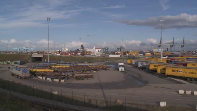 MS Shot of Containers freight on dock in port / Zeebrugge, Flanders, Belgium