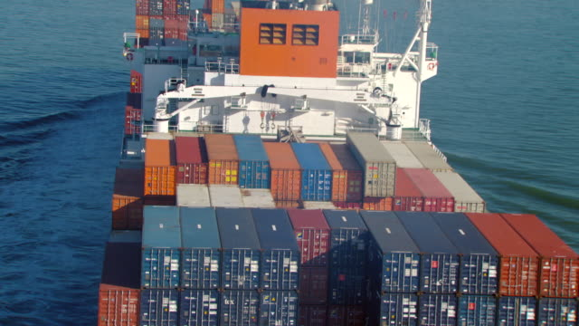 MS ZO AERIAL Shot of containers to cargo ship on Ocean / Oakland, California, United States