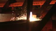 MS Shot of continnous casting line at steel mill / Esch sur Alzette, Esch, Luxembourg