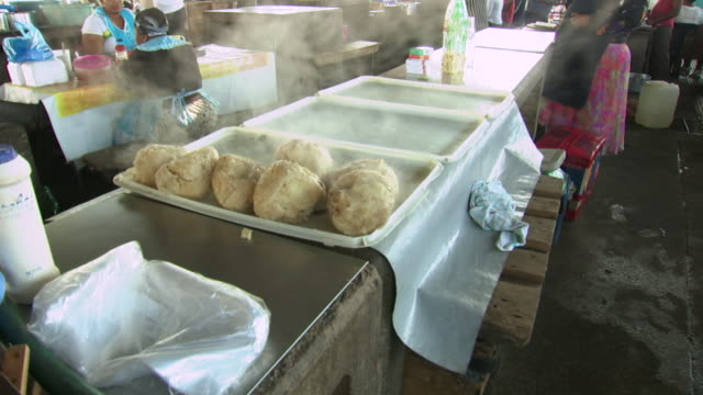 MS Shot of cooked cow brains in a tray for sale at Warwick Junction market / Durban, South Africa
