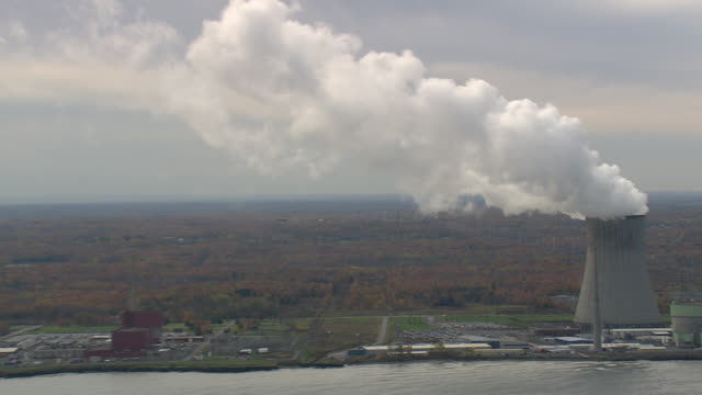 WS AERIAL ZI ZO TS Shot of Cooling Tower on shore of Lake Ontario / New York, United States