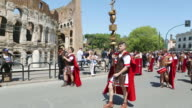 MS Shot of Costumes parade for anniversary of birth of Rome, also known as Natale di Roma, People dressed as ancient romans and gladiators walks along landmarks of city  AUDIO / Rome, Italy