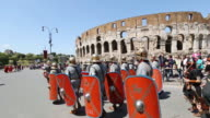 MS TS Shot of Costumes parade for the anniversary of the birth of Rome, also knowns as 'Natale di Roma' People dressed as ancient romans and gladiators walks along the landmarks of the city / Rome, Italy