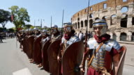 MS Shot of Costumes parade for the anniversary of the birth of Rome, also knowns as 'Natale di Roma' People dressed as ancient romans and gladiators walks along the landmarks of the city / Rome, Italy