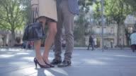 CU PAN LA Shot of couple legs standing in park / Toulouse, Haute Garonne, France