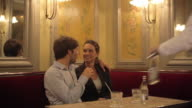 CU TS Shot of Couple sitting at table in restaurant being served drinks / Toulouse, Haute Garonne, France
