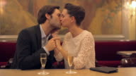 CU PAN Shot of Couple talking and kissing with champagne at restaurant / Toulouse, Haute Garonne, France