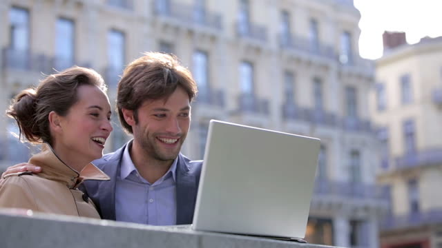 CU LA Shot of Couple using a laptop outside / Toulouse, Haute Garonne, France