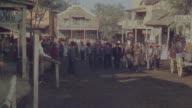 MS Shot of cowboys in village area
