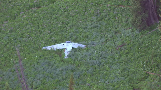 CU AERIAL TS DS Shot of Crashed airplane at Mount Leidy / Wyoming, United States