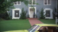MS Shot of cream color ford car standing in front house and man entering in house
