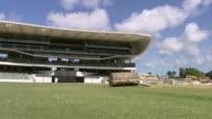 WS Shot of cricket pitch roller on ground at Kensington Oval stadium / Bridgetown Barbados