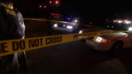 CU PAN Shot of crime tape by ambulance and police cars at crime scene / Pittsburgh, Pennsylvania, United States