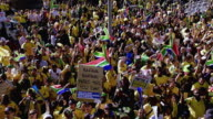 MS SLO MO Shot of Crowd of people during United We Shall Stand Parade in Sandton, Johannesburg / Johannesburg, Gauteng, South Africa