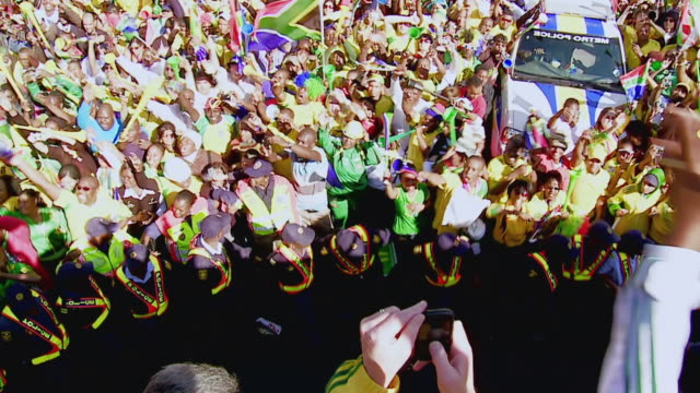 MS HA Shot of Crowd of supporters from bus during United We Shall Stand Parade in Sandton / Johannesburg, Gauteng, South Africa
