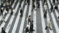MS Shot of crowds of people crossing street / Osaka, Japan