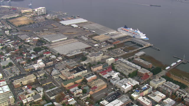 MS AERIAL Shot of cruise ship at dock in Charleston city / South Carolina, United States