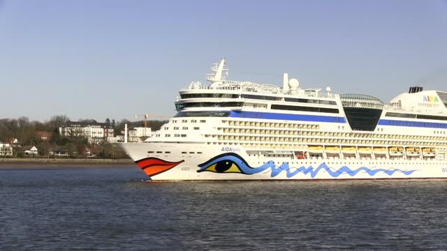 MS Shot of cruise ship on river Elbe near Finkenwerder / Hamburg, Germany
